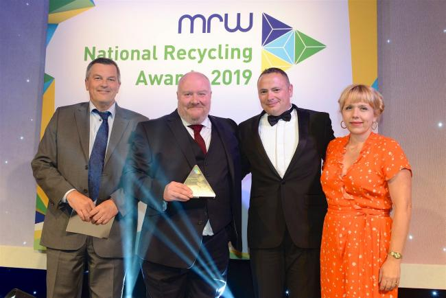 AWARD: Egbert Taylor's Kevin Docherty and Nathan's Wastesavers' Peter Page collect the National Recycling Award from actress and comedian Kerry Godliman