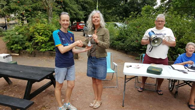 Sharon Brett from Crowle is handed the petanque winning trophy by Carrie Parsons from sponsors Parsonson Planning Consultancy. Picture: SUE COLLINS