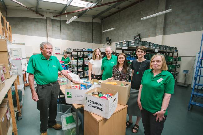 KIND: Staff from Speller Metcalfe taking their donations to the Malvern Hills Foodbank