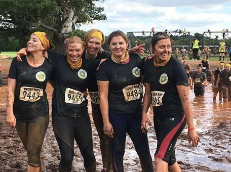 Team Quora from Shipston Home Nursing celebrate their achievement in completing the Wolf Run