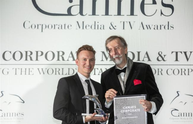 AWARD: Dominic Allen picking up the silver dolphin at Cannes for his film about alopecia