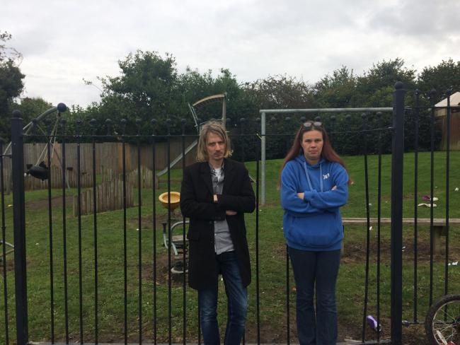 Councillor Michael Thompson and concerned resident Jennie Peplow outside the neglecvted playground on Tibberton Road.