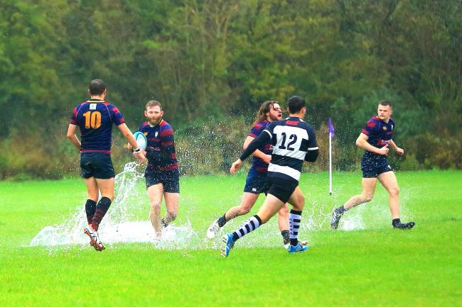 Evesham players splash about against Stratford before the game was abandoned. Picture: ROLAND BAILEY