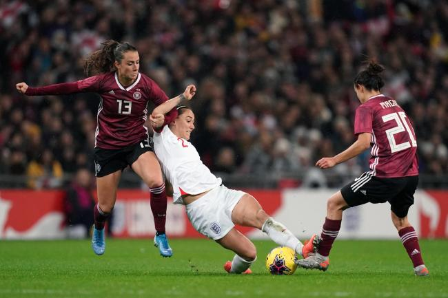England Women conceded late on to suffer a 2-1 defeat to Germany in front of a record-breaking Wembley crowd