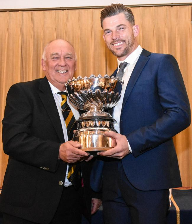 Richard Preen (right) receives the Lloyd Cup from club captain Andy Basford. Picture: BROADWAY GOLF CLUB