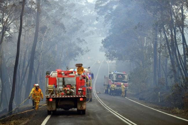 DEVASTATION: Firefighters work to extinguish a bushfire in Dargan, some 120 kilometres from Sydney (Photo by Saeed KHAN / AFP) (Photo by SAEED KHAN/AFP via Getty Images).