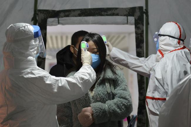 Tests carried out in China this week. Picture: Chinatopix via AP/PA Wire