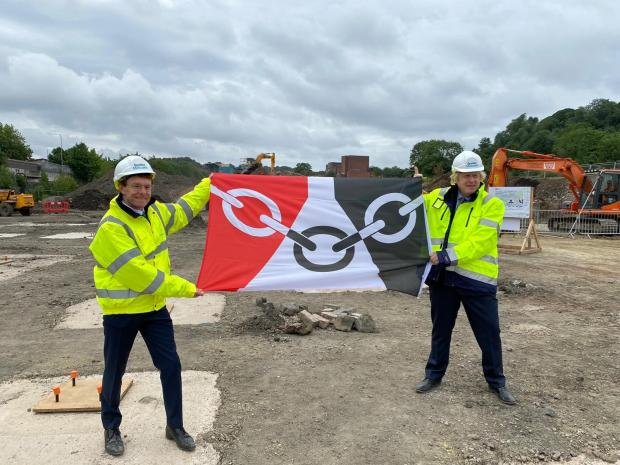 Cotswold Journal: Andy Street, Mayor of the West Midlands, and Prime Minister Boris Johnson hold up the Black Country flag