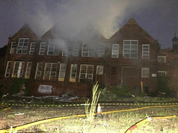 Cotswold Journal: The former school building in Blowers Green Road, Dudley, where firefighters worked through the night to fight the flames. Pic - West Midlands Fire Service