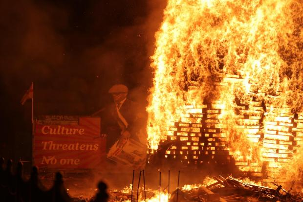 A bonfire is lit on Belfast's Lower Newtownards Road