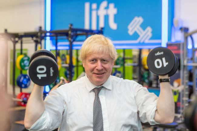 Handout photo dated 06/08/20 issued by The Gym Group showing Prime Minister Boris Johnson lifting a few rounds of weights at a branch of The Gym Group in his South Ruislip constituency. PA Photo. Issue date: Thursday August 6, 2020. Boris Johnson vowed to