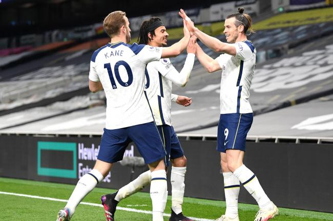 Dele Alli (centre) celebrates with Harry Kane (left) and Gareth Bale
