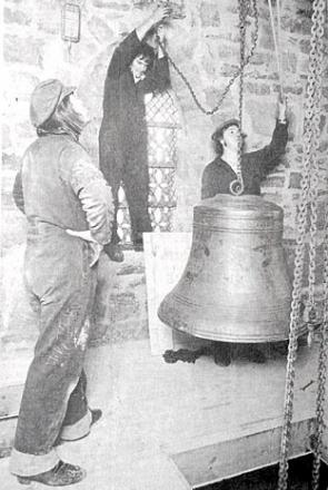 Workman hanging the new bell in St Mary's, Aston Somerville