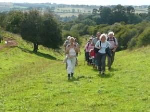 Cotswold voluntary warden, Jill Stuart, leading a walk near Guiting Power