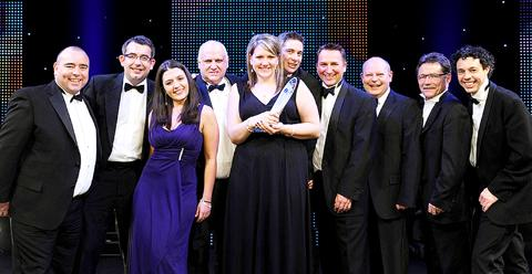 Contractor of the Year: Staff members from Thomas Vale Construction and their associates with the award.