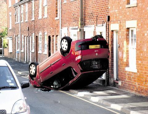 Joanne Lea's car flipped onto its roof.