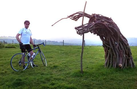 CHARITY CHALLENGE: Neil Waterman alongside the Witch & I by the Rollright Stones.