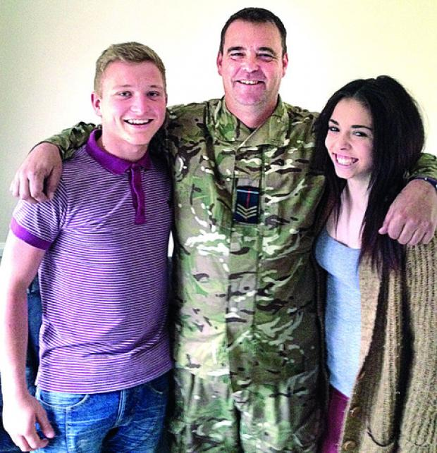 Army sergeant Adrian Whitaker with his daughter Kirby and her boyfriend Jacob Knight. Adrian and Jacob saved the life a woman after a fire broke out in her home.