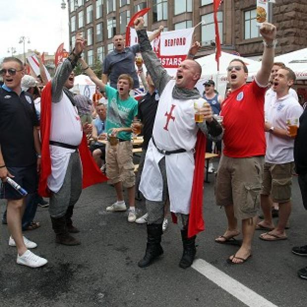 England fans have moved their base to an unofficial location in the fanzone in Kiev in response to 'rip off' bar prices elsewhere
