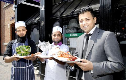 NOMINATED BY MP: Left to right: Junior chef Mohammed Ahmed, head chef Abdul Uddin and manager Sam Ahmed from Pasha in St John's. The restaurant was a regional finalist in the Tiffin Cup. Picture by Nick Toogood.