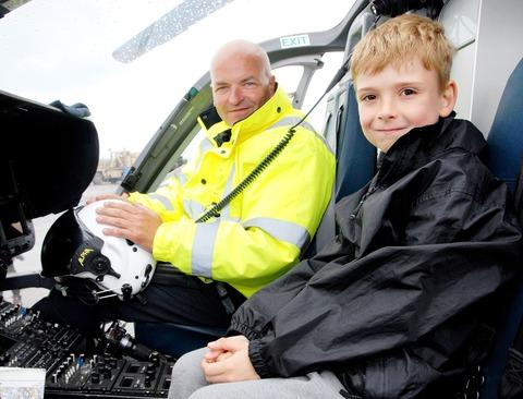 Eight-year-old Ben Allen is shown around the Midlands Air Ambulance.