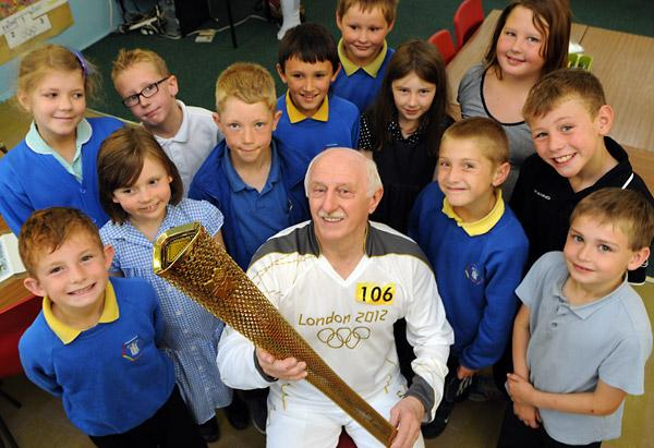 Cotswold Journal: Stan Wild shows the Olympic torch he carried in the relay through York to youngsters at Tang Hall school