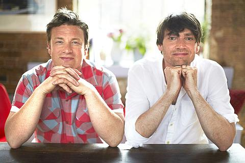 MUSIC and FOOD: Celebrity chef Jamie Oliver with rocker turned cheesemaker Alex James at whose Cotswold farm he will be appearing for a new festival