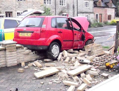 DESTRUCTION: The most recent crash into Tom Wardle's front garden.