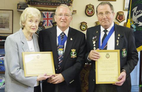 AWARD: Ted and Margaret Annis with their respective certificates, presented by national RNA chairman Chris Dovey, in the centre.