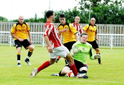 MY BALL: Evesham United striker Marcus Palmer (front) battles for possession during his side's 3-0 defeat to Blue Square Bet Premier outfit Newport County on Saturday. Picture: PAUL JACKSON. 28087508