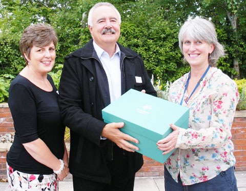 Christine Fleetwood and Phil Humphreys, of Pendragon Packaging, with Sarah Popplestone-Helm, of St Richard's Hospice and one of the memory boxes.