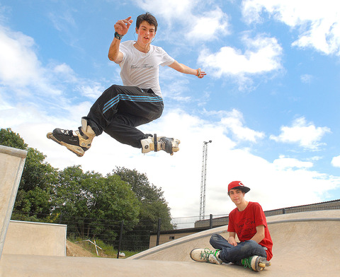 Liam Annakin watches Ollie Leopard perform tricks at the new skate park in Moreton