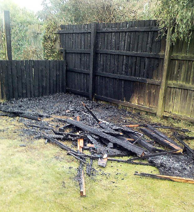The charred remains of the playhouse.