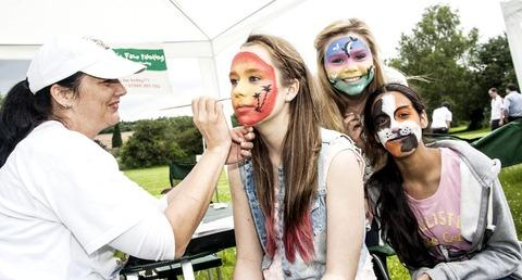 SUPPORT: Youngsters enjoy some face painting during the CP Foods fund-raising extravaganza for the Maggs Day Centre.