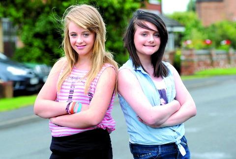 Friends Kaitlin Canning, left, and Caitlin McMillan, both aged 12, who helped save the life of a boy who was hit by a car.