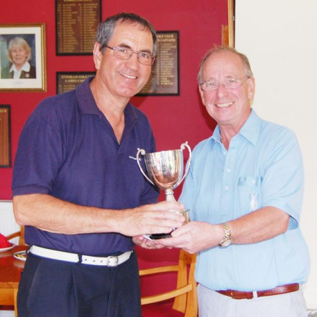 BEES KNEES: Evesham Golf Club's Seniors captain Mike Abraham (right) presents the Diffin Trophy to Alan Bees.