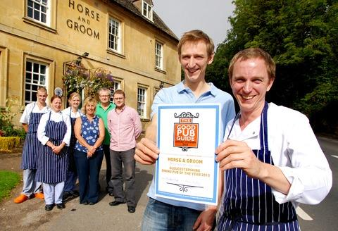 HONOUR: Tom Greenstock, front left, with his brother Will, the head chef, and pub staff celebrate the Horse and Groom at Bourton-on-the-HIll winning the Good Pub Guide accolade. Picture by Paul Jackson. 36124301