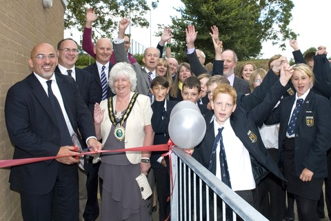 Stratford MP Nadhim Zahawi cuts the ribbon, watched by Shipston mayor Fay Ivens and youth club supporters and pupils. Picture taken by Richard Sampson.