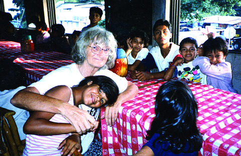 Bron Soan with some of the El Salvadorean children she has helped through her fund-raising.
