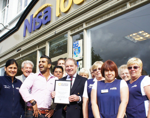 DELIGHT: Mickleton Village Stores owner Narjinder Dhasee with his staff as they are presented with the My Shop is Your Shop Community Retailing Award by Cotswold MP Geoffrey Clinton-Brown