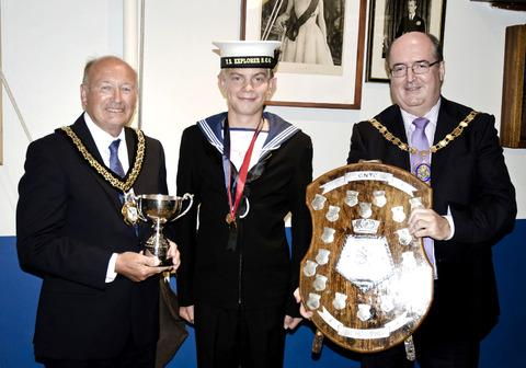 Cotswold Journal: PRIZE GUY: Daniel Ludlow (middle) is congratulated on his Sea Cadet Windsurfing title by councillors Robert Adams (left) and Richard Morris. Picture: RUPERT SEGAR
