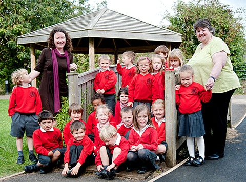 Reception class pupils of St Catharine's Primary School with Headteacher Joanne Welch (left) and deputy head and reception class teacher Jane Cannon (right).
