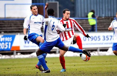 HIT MAN: Marcus Palmer (red and white) was on target as Evesham United beat second-in-the-table Cirencester Town.