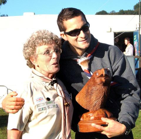 BEAR HUG: Chief Scout Bear Grylls with Ann Clark, deputy county commissioner.