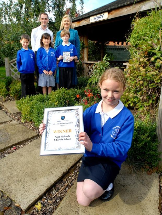 AWARD: Nicola Sinclair, aged nine, front, and, back from left, Nat Buttle, nine, Matthew Richards, eco co-ordinator, Amelia Browning, nine, headteacher Elizabeth Spencer and Hayden Salter, nine.