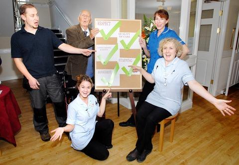 CELEBRATION: Pictured at Mill House Care Home are, from left, maintenance worker Robert Gyorgy, resident Brian Wade, and staff carers Gemma Bishell, Ellish Flambert and Denise Taylor.