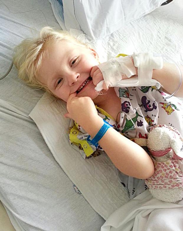 SMILE: Molly Grove, three, recovering after the operation that will allow her to walk.