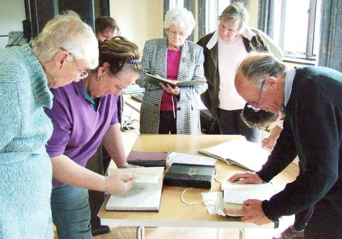 MEMORIES: People looking at old school log books during the Mickleton archive day.