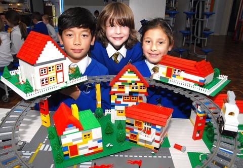 BRICKS: An Evesham school used Lego to learn about town planning. Pictured are Louis Bishell, aged 10, Sasha Simonett, eight, and Francesca La Paglia, eight. 42157201