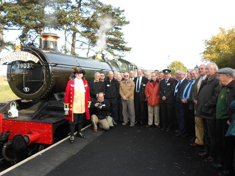 GWR volunteers, including chairman Malcolm Temple (front second right) and Cheltenham town crier Ken Brightwell celebrate the first run over the restored full length of line between Toddington and Cheltenham Racecourse.